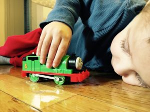 Child playing with Train, Autism, The Key Consulting Firm